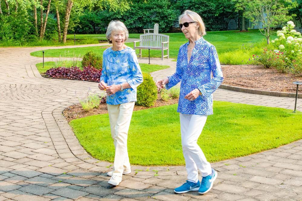 two senior women taking a walk outside